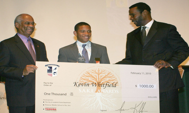 Commissioner Hayward Benson, Kevin Whitfield, & Irvin Kiffin with Check