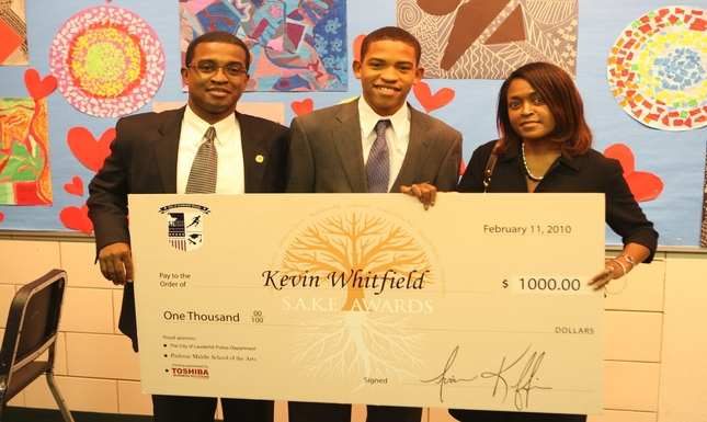 Kevin Whitfield with Parents & Check