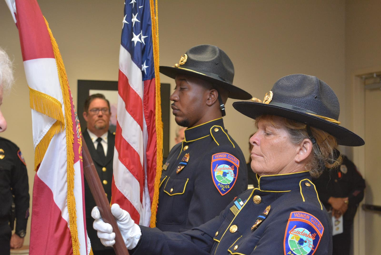 Officers McGriff & Geronimo holding the flags