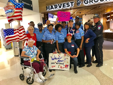 Seventy-five(75) WWII, Korean and Vietnam War Veterans greeted by COP members at FLL Airport