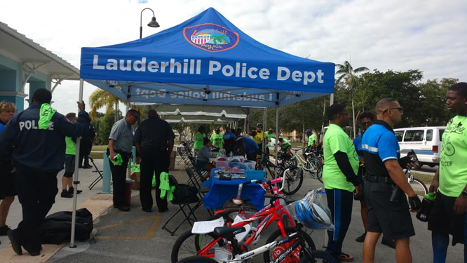 Lauderhill Police Tent at Slow Roll with attendees
