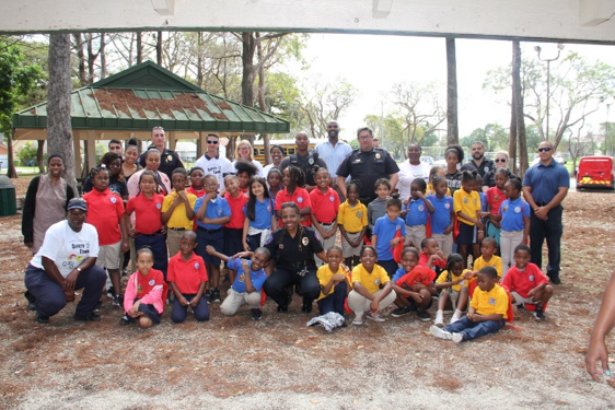 Group picture of LPD Officers and participating kids together during Safety Town