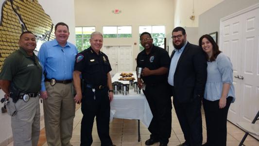 Lauderhill Police officers with Synagogue of Inverrary Chabad members having coffee, cookies and muffins.