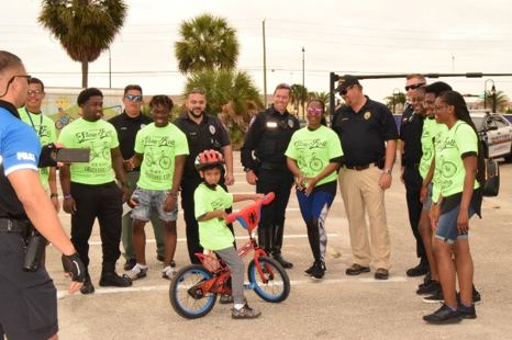 LPD Officers and participating kids having a good time during Final Slow Roll event