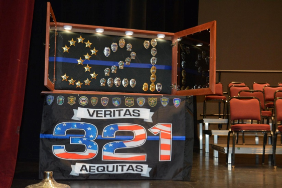 Veritas 321 Aequitas - Police Badges in Display Case
