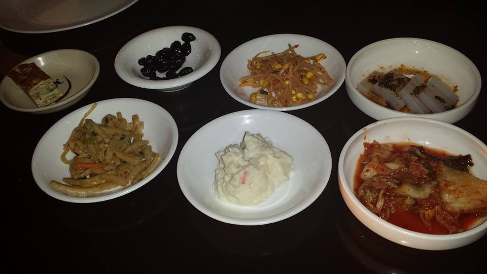 Assorted plates of side dishes