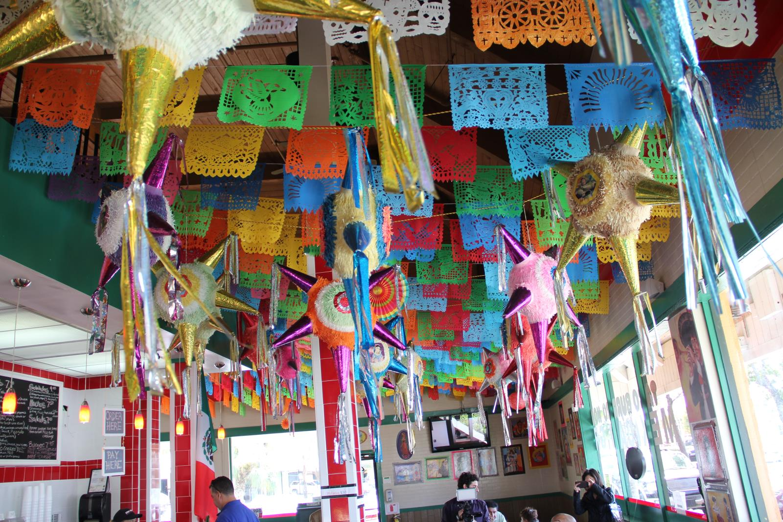 Pinatas on Chicano's ceiling