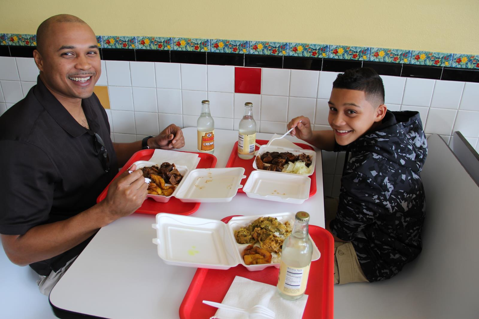 Sean Henderson and son enjoying food