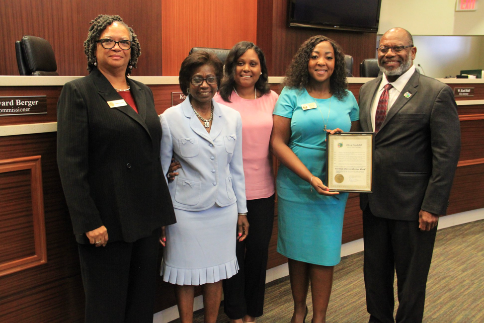 The Caribbean American Bar Association Members gladly accepting Proclamation