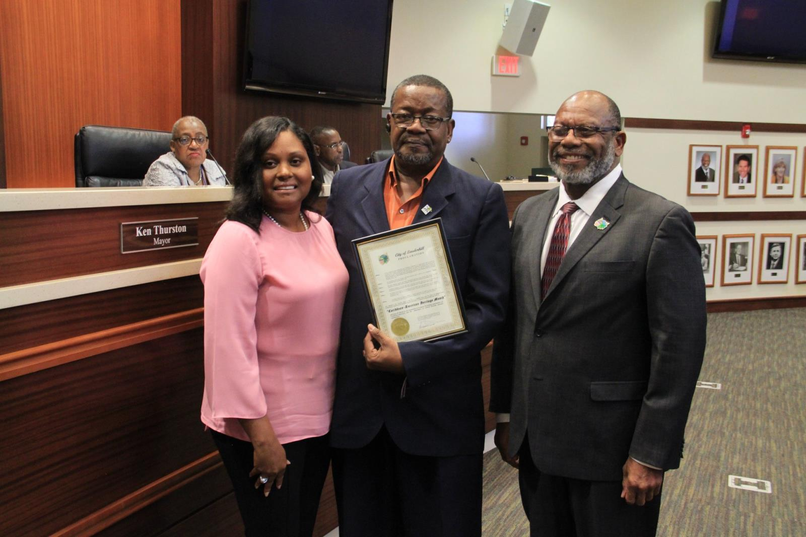 Glenn Joseph, of the Greater Caribbean American Chamber of Commerce, receiving proclamation