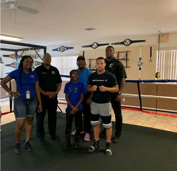 Lauderhill's Police Athletic League Boxing Program Coordinators and Participants