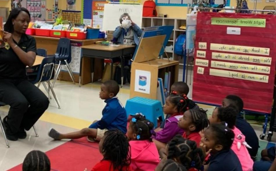 Detective Tara Walker reading at Endeavor Primary Learning Center
