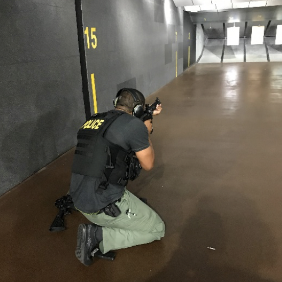 Officer crouching for rifle target practice