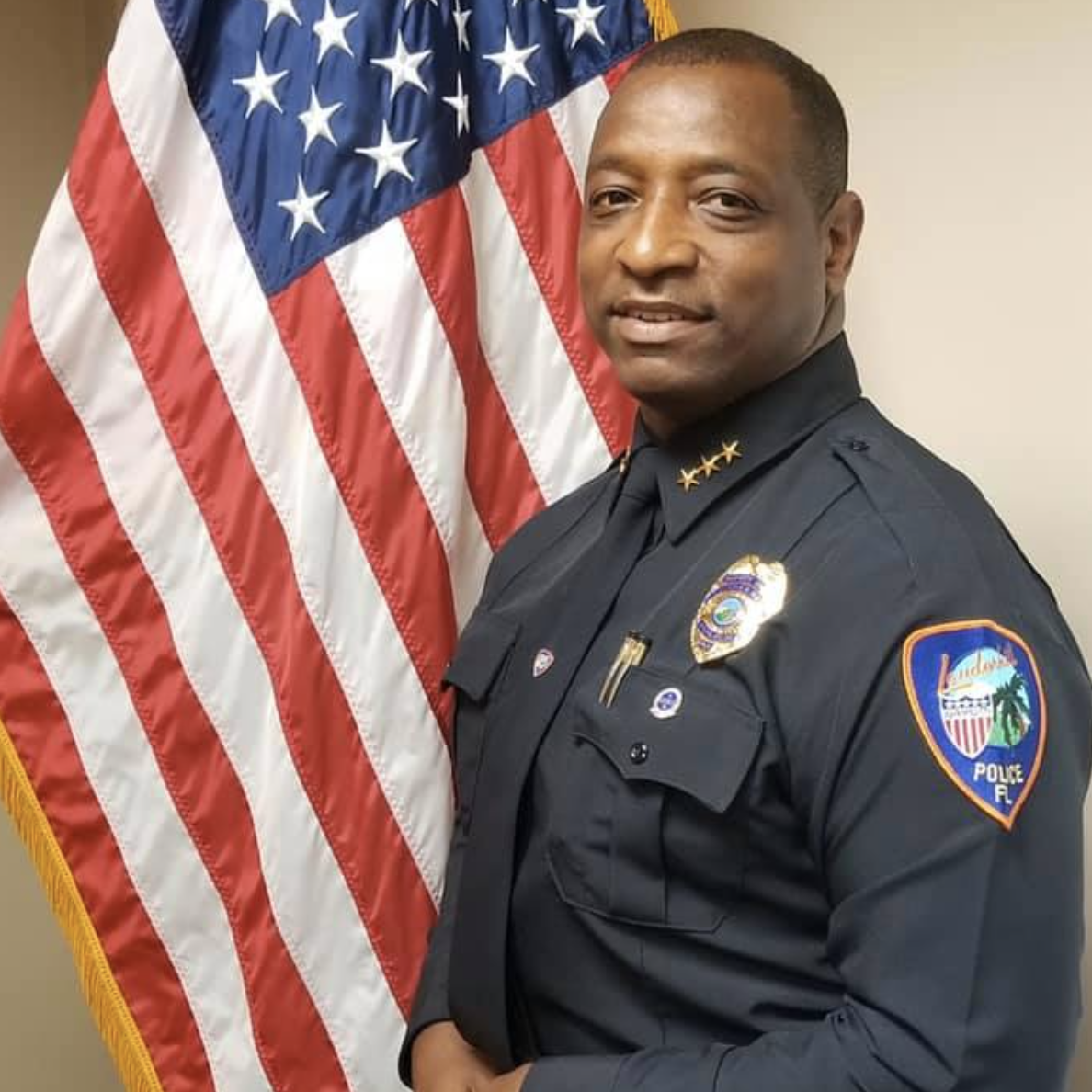 Chief Deputy Belcher in uniform with American flag