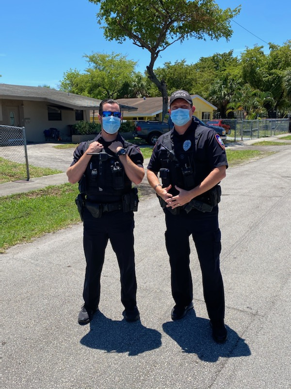 Two police officers on a residential street