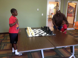 Youth Chess Players with Board