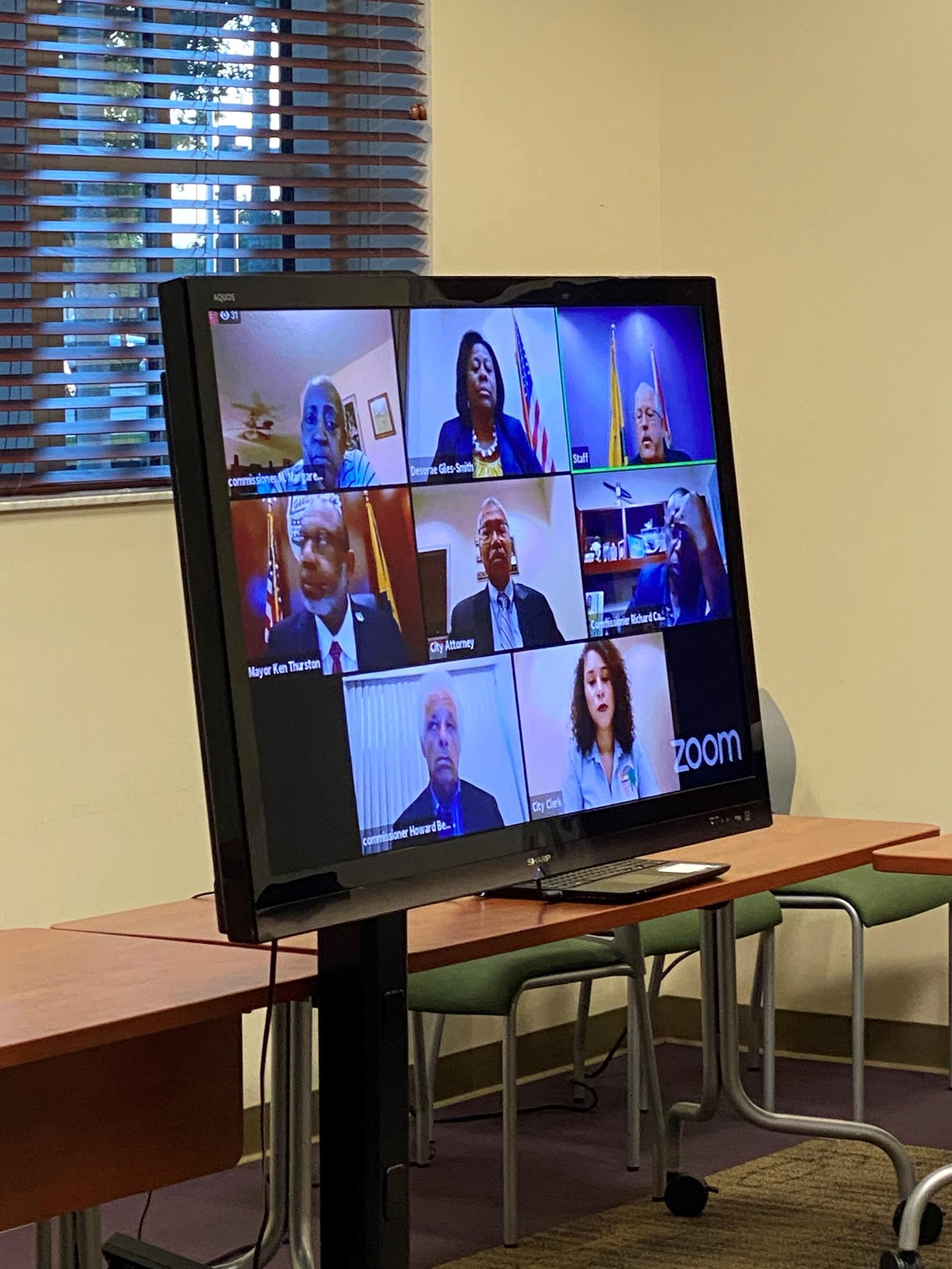 Commission & Senior Staff Participating in a Zoom Virtual Commission Meeting from homes & offices